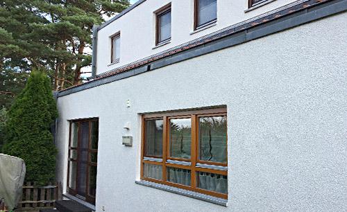 Malerarbeit an Fassade in Ochsenwerder